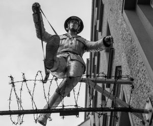 monument to Conrad Schumann jumping over the Berlin wall